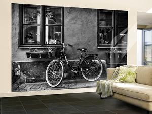 A Bicycle Parked on a Sidewalk Below Two Windows by Jonathan Irish