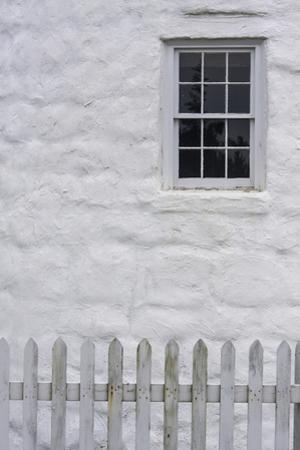Close Up of Stone Masonry, Window, and White Picket Fence by Jonathan Irish