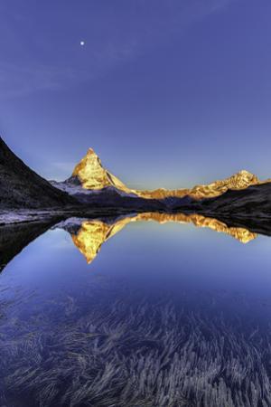 Early morning sun on the Matterhorn Mountain, reflected in Riffelsee lake by Jonathan Irish