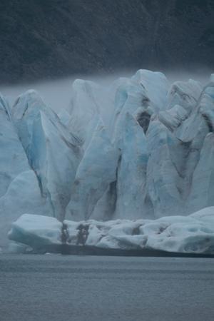 Fog over Bear Glacier in Kenai Fjord National Park. by Jonathan Irish