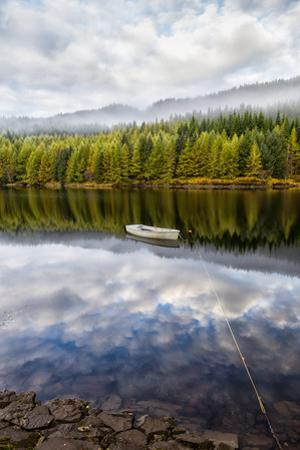 Reflection of Boat and Trees in a Scottish Lake by Jonathan Irish