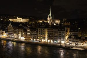 Zurich at Night, and its Reflection in the Limmat River by Jonathan Irish