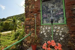 A Small Shrine with a Crucifix Behind Glass on Taboga Island by Jonathan Kingston