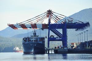 Giant Cranes Load a Massive Container Ship Moored in Prince Rupert's Harbor by Jonathan Kingston