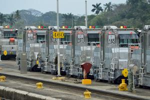 Mechanical Mules or Electric Locomotives Line the Panama Canal by Jonathan Kingston