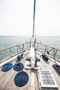 The Bow of a Wooden Sailboat on the Ocean in Panama by Jonathan Kingston