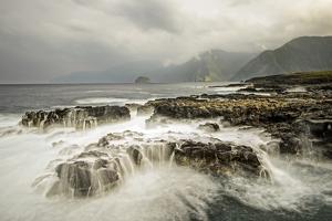 The Pacific Ocean Breaks over the Rocky Shoreline of the Kalaupapa Peninsula, Molokai, Hawaii by Jonathan Kingston