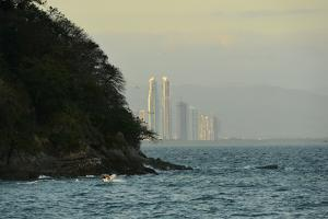 The Skyline of Panama City Partially Obscured by Isla Flamenco in Panama Bay by Jonathan Kingston