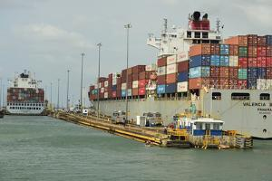 Two Large Container Ships, Stacked High with Colorful Containers, Enter the Gatun Locks by Jonathan Kingston