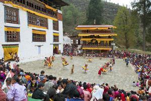 Crowds Watching the Dancers at the Paro Festival, Paro, Bhutan, Asia by Jordan Banks