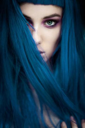 Young Adult Female with Bold Eye Shadow And Long Blue Hair