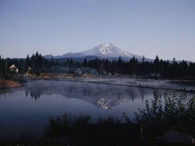 A Lumber Mill with Mount Shasta in the Background
