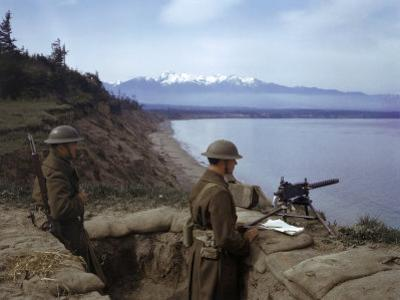 American Soldiers Guard the Coast with a Machine Gun in a Trench