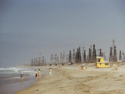 Beach Scene with Oil Rigs in the Background
