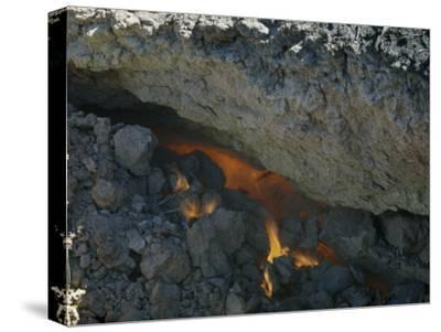 Close-up Through Crevice of Underground Flames Consuming Lignite Coal
