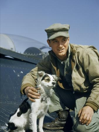 Marine Corps Corporal Poses with Squadron's Mascot on Panther Wing