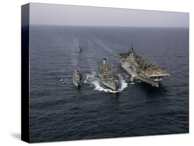 Navy Ships Refuel at Sea, Last Ship Acts as Guard for Men Overboard