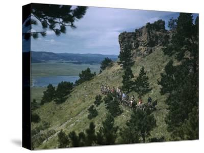 Sightseers Climb Bear Butte on Mules to Enjoy Scenic Vistas