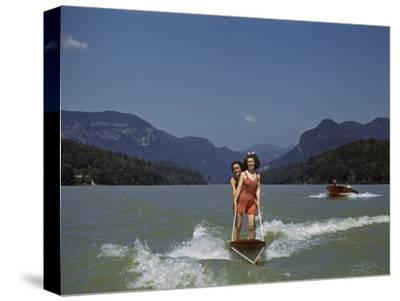 Two Women Water Ski on Lake Lure, Another Speedboat Follows