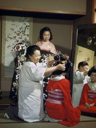 Women Demonstrate the Art and Custom of Dressing a Bride