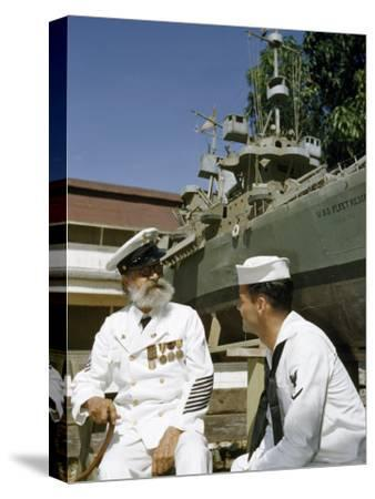 Young Petty Officer Talks with a Retired Chief Petty Officer