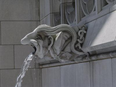 A Neo-Gothic Limestone Gargoyle Spewing Water from its Mouth