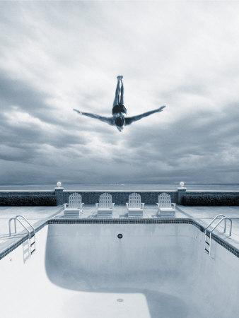 Man Diving Into an Empty Pool