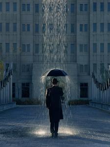 Man with Umbrella Under a Regional Rain by Joseph Hancock
