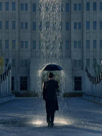 Man with Umbrella Under a Regional Rain