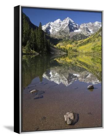 Aspens reflecting in lake under Maroon Bells, Colorado