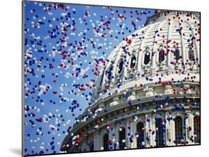 Balloons Floating over U.S. Capitol Dome by Joseph Sohm