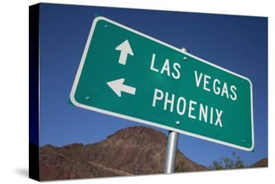 Road Sign Points to Las Vegas and Phoenix