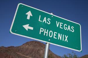 Road Sign Points to Las Vegas and Phoenix by Joseph Sohm