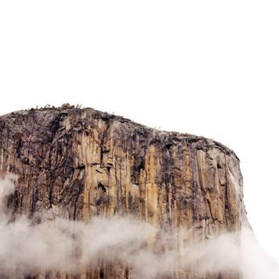 Sheer cliff rising above clouds by JoSon