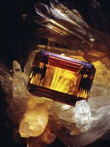 Citrine Resting on a Crystal by Jr Victor R^ Boswell
