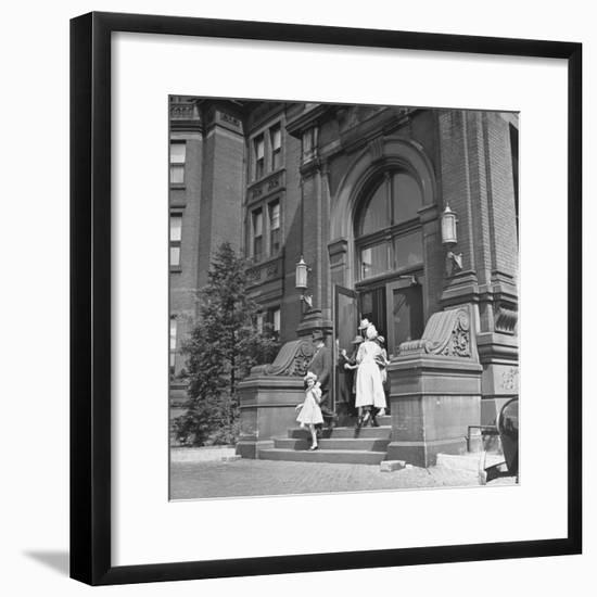 Juan Andreu Almazan Leaving John Hopkins Hospital with a Small Friend-Thomas D. Mcavoy-Framed Premium Photographic Print