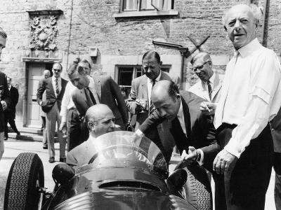 Juan Manuel Fangio at the Wheel of a V16 BRM, 1960s--Photographic Print