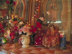 Altar with Candles, Flowers, and Spiritual Imagery for the Day of the Dead Celebration, Mexico by Judith Haden