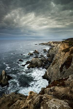 California. Clouds Approaching Cliffs and Surging Waves at Bodega Head, Sonoma Coast State Beach