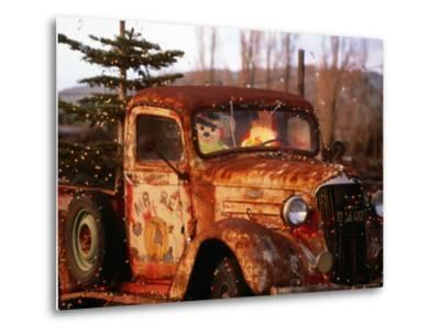 Rusty Old Truck Strung with Christmas Lights, with Santa Claus at Wheel