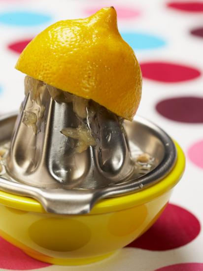 Juicer with Bowl and Lemon Half on Polka Dot Surface--Photographic Print