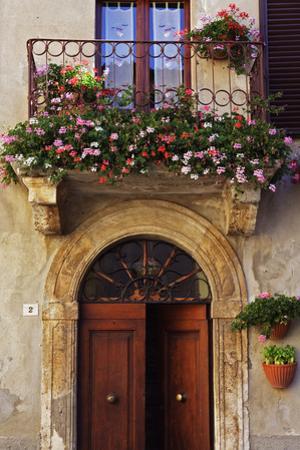 Balcony Flowers and Doorway in Pienza Tuscany Italy
