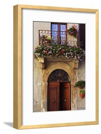 Balcony Flowers and Doorway in Pienza Tuscany Italy