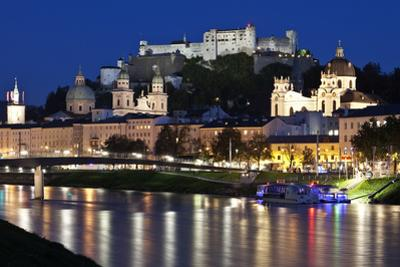 City at Night of Salzach River with Churches of Salzburg and Hohensalzburg Fortress, Austria