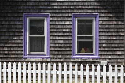 Exterior of a Shingle Carpenter Gothic (Gingerbread) Cottage with White Picket Fence