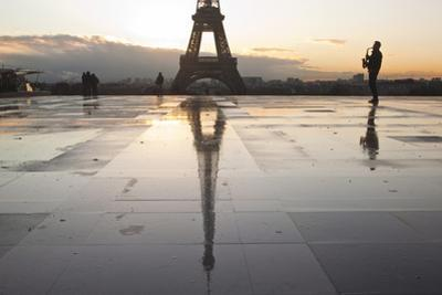 A Man Playing a Saxophone in Front of the Eiffel Tower, Paris, France, Europe by Julian Elliott