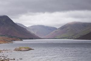 Low Rain Clouds Surrunding the Fells Above Wast Water in the Lake District National Park by Julian Elliott