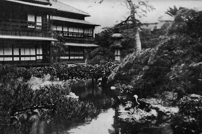 'A tea-house garden, Tokyo. Landscape gardening with theme of volcanic origins', c1900, (1921)