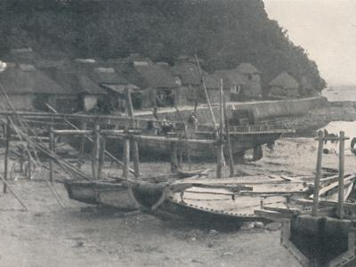 'Tai-no-ura - Tiny houses on a margin of sand with fishing boats', c1900, (1921)