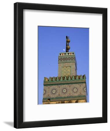 A Minaret with the Early Moon in the Background; Old Medina in Fes, Morocco